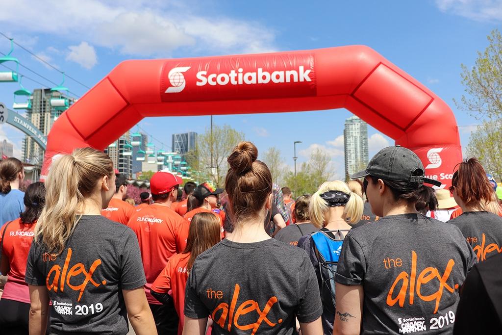 Alex staff stand at marathon entrance