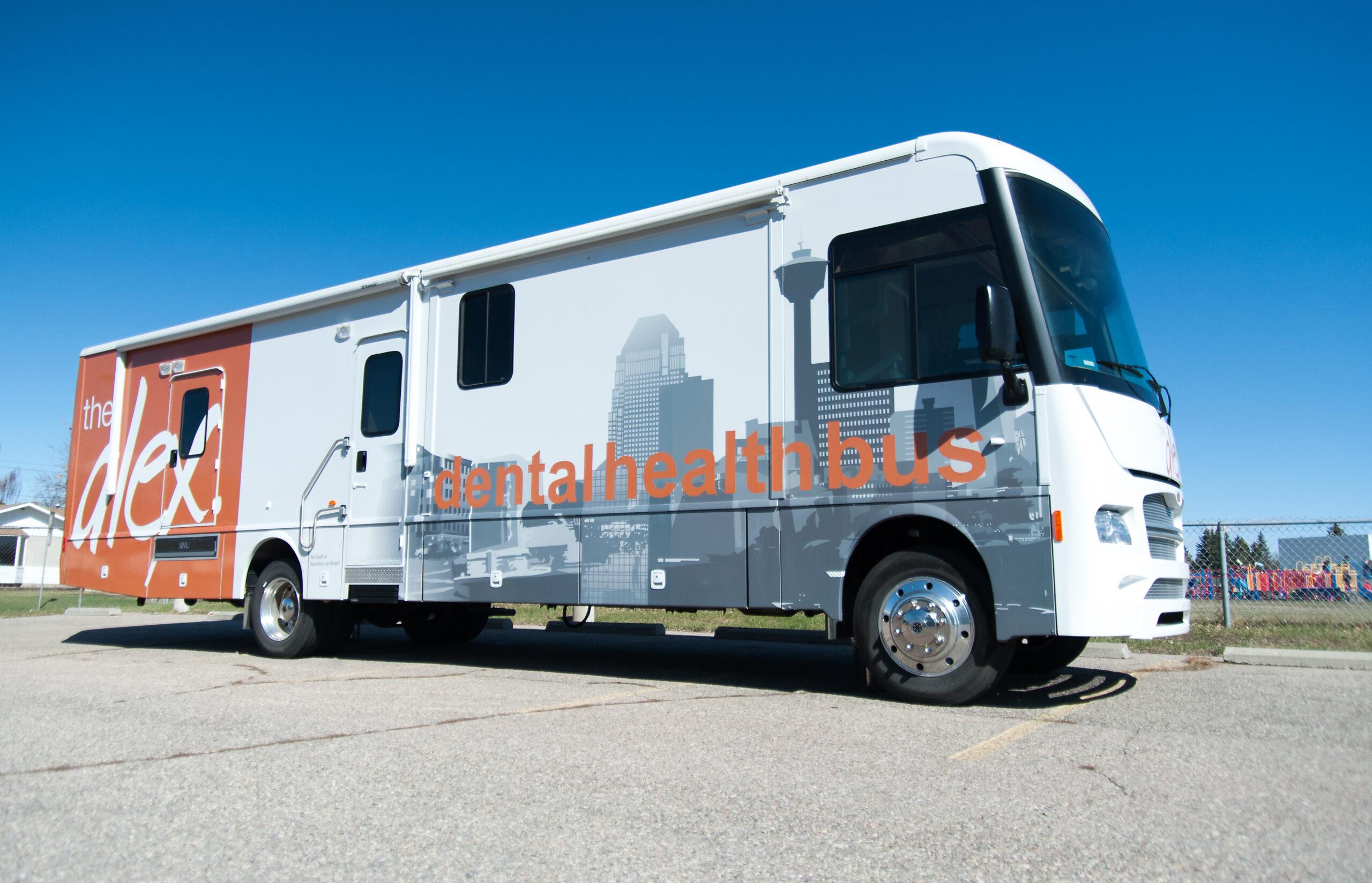A side-profile photo of The Alex Dental Health Bus