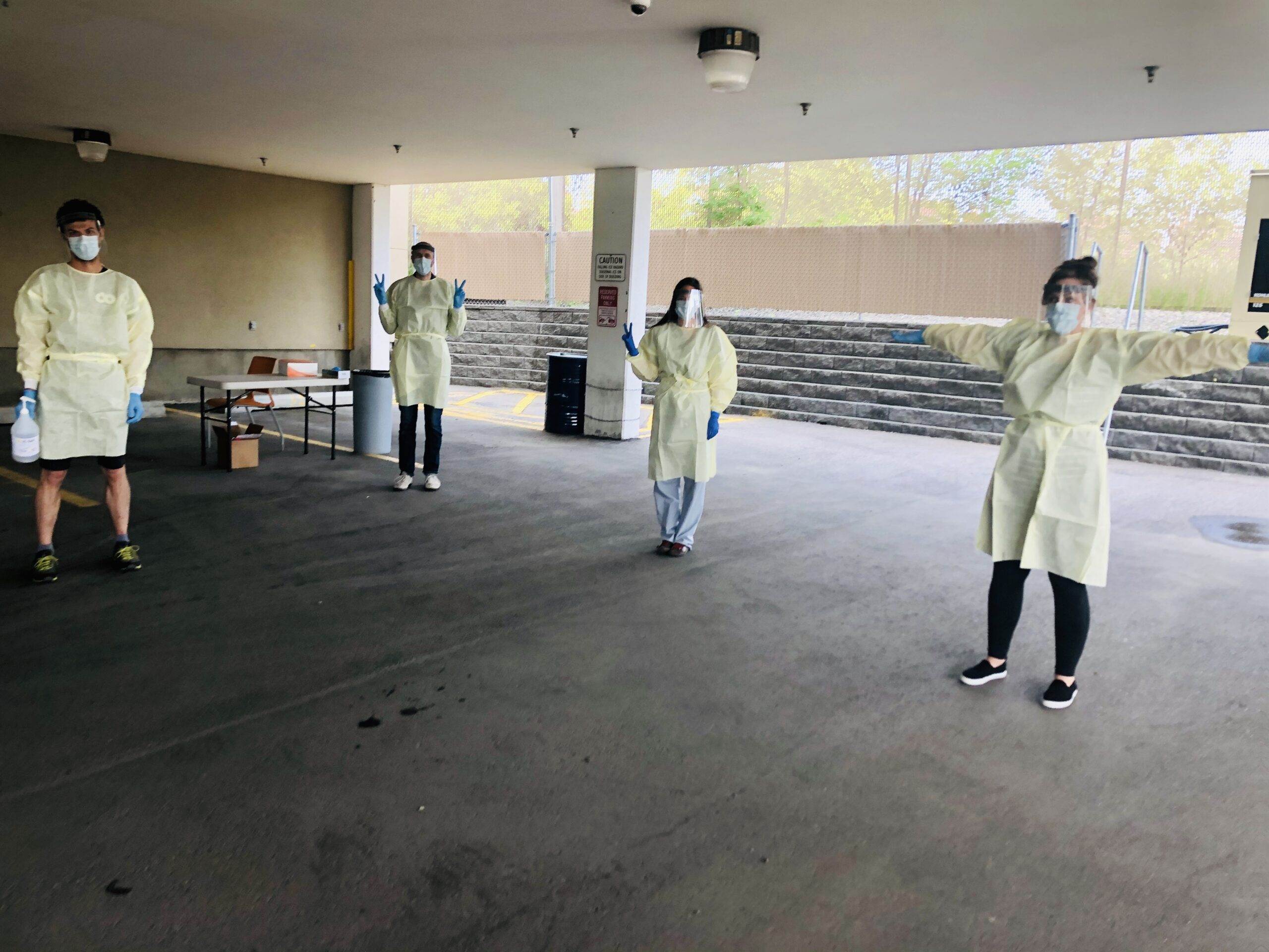 group of 4 Alex staff dressed in full PPE standing 6 feet apart